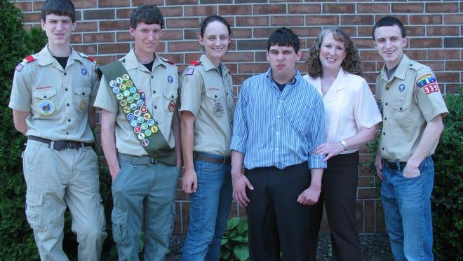 Jeanie Lan Der, second from right, stands with her children during their  Scouting years.