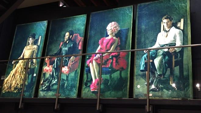 "Portraits of ""Hunger Games"" characters Johanna (Jena Malone), Cinna (Lenny Kravitz) Effie Trinket (Elizabeth Banks) and Finnick (Sam Claflin)."