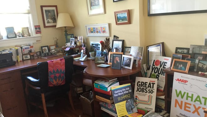 This Sept. 23, 2016 photo provided by Kerry Hannon, an author, motivational speaker and AARP Jobs Expert, shows her home office in Washington, D.C. Hannon and her husband are one of a growing number of couples who work from home.  (Kerry Hannon via AP)