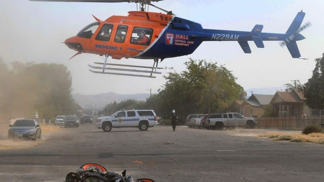 Helicopter lifts off with injured motorcyclist at Elm and Pierce Tuesday afternoon