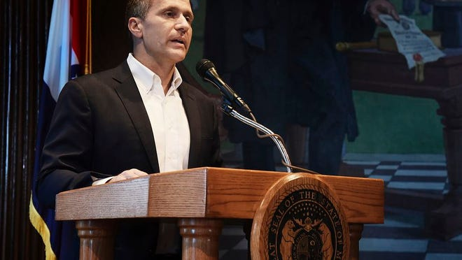 File-Missouri Gov. Eric Greitens reads from a prepared statement as he announces his resignation during a news conference, Tuesday, May 29, 2018, at the state Capitol, in Jefferson City, Mo. The Navy appeared reluctant to reinstate former Navy SEAL and Missouri Gov. Greitens in 2019 until Vice President Mike Pence's office intervened, according to newly released documents. Greitens resigned as governor in 2018 amid several political scandals.