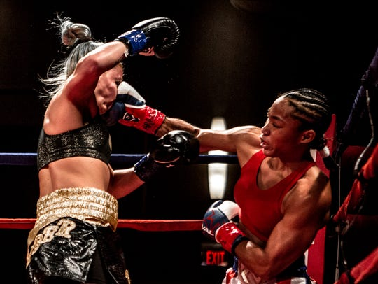 Alycia Baumbardner, making her professional boxing debut in March 2017,  lands a right cross en route to knocking out of Britain Hart, the first of her four pro boxing victories.