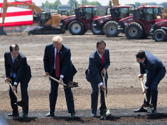 President Trump (second from left) is joined by Gov. Scott Walker (left), Foxconn Chairman Terry Gou and House Speaker Paul Ryan (right) Thursday, June 28, 2018, during the ceremonial groundbreaking for Foxconn's factory in Mount Pleasant, Wis. The Taiwanese-based firm has said  it remains committed to investing the full $10 billion in what it has named the Wisconn Valley Science and Technology Park, and to creating 13,000 jobs. The factory will create display panels out of immense sheets of wafer-thin glass.