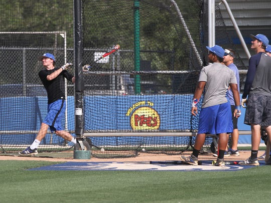 Danny Cunningham, along with other members of Canterbury's varsity baseball team, work on batting practice at FGCU on Tuesday.