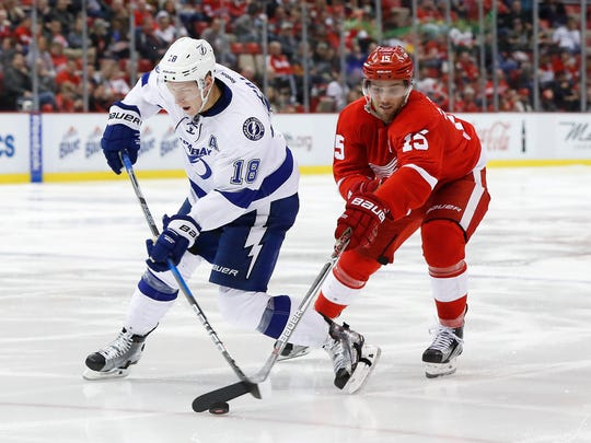 Red Wings center Riley Sheahan steals the puck from Tampa Bay Lightning left wing Ondrej Palat in the third period Nov. 15, 2016 in Detroit.