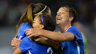 USA midfielder Morgan Brian (14) , defender Sydney Leroux (2) and forward Abby Wambach (20) celebrate a goal in the second half of the game against Mexico at StubHub Center on May 17, 2015.