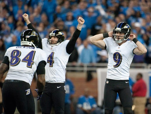 Baltimore Ravens kicker Justin Tucker (9) celebrates his game winning field goal with punter Sam Koch (4) and tight end Ed Dickson (84) during the fourth quarter against the Detroit Lions at Ford Field. Ravens won 18-16.