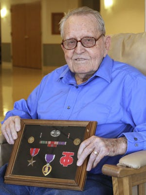 Oscar Moore, 89, earned the Bronze Star and the Purple Heart in Europe.