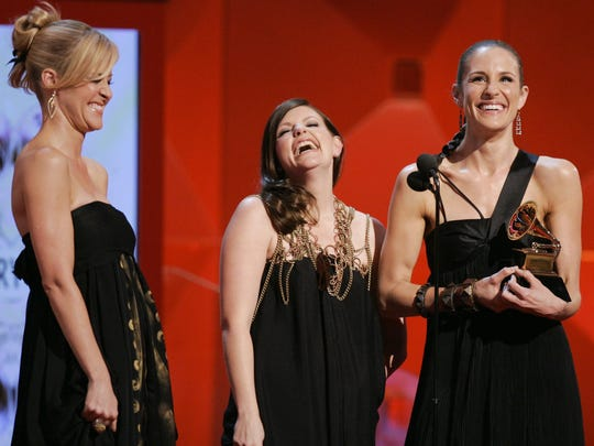 "From left, Martie Maguire, Natalie Maines and Emily Robison of the Dixie Chicks accept their Grammy for best country album for ""Taking the Long Way"" in 2007 during the 49th Annual Grammy Awards in Los Angeles."