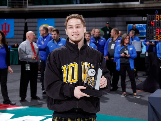 Iowa's Spencer Lee poses with his freshman of the year award following the Big Ten championship matchs, Sunday, March 4, 2018, in East Lansing, Mich.