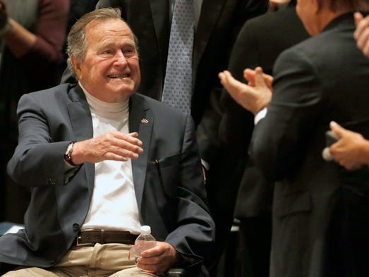Former president George H.W. Bush acknowledges the