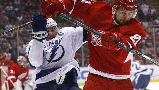 Tampa Bay's Steven Stamkos tangles with the Red Wings' Tomas Tatar.