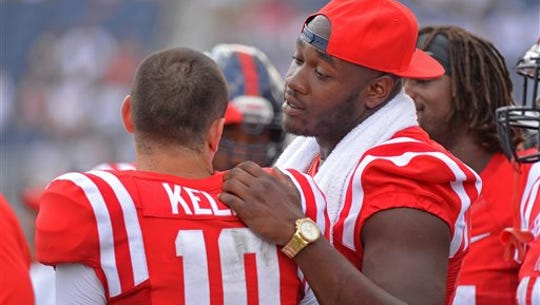 Mississippi offensive lineman Laremy Tunsil, right,