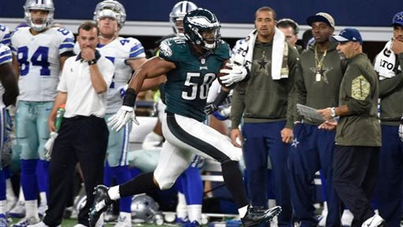 Eagles' linebacker Jordan Hicks (58) runs back an interception 67 yards for a touchdown in the against the Dallas Cowboys  on Sunday night.