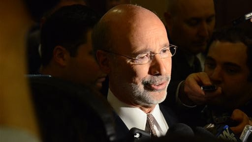 Gov. Tom Wolf responds reporters' questions after speaking at a Pennsylvania Press Club luncheon Nov. 23 in Harrisburg.