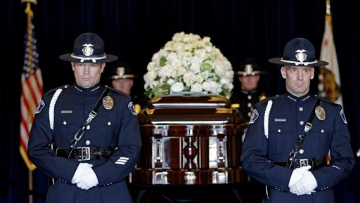 "FILE - In this Thursday, March 10, 2016 file photo, four honor guards stand near the casket of Nancy Reagan at the Ronald Reagan Presidential Library, in Simi Valley, Calif. The former first lady will be buried beside her ""Ronnie"" Friday, March 11, 2016, at the library they loved, after being mourned and celebrated by family and hundreds of friends from Hollywood, Washington and beyond in a private service. Mrs. Reagan, who died Sunday at 94, planned the smallest details of her funeral. (AP Photo/Jae C. Hong, Pool, File)"