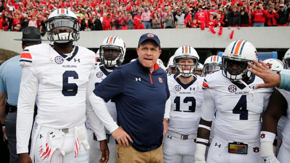 Auburn head coach Gus Malzahn waits with his players to run onto the field for an NCAA college football game against Georgia Saturday, Nov. 12, 2016, in Athens, Ga. Georgia won 13-7.