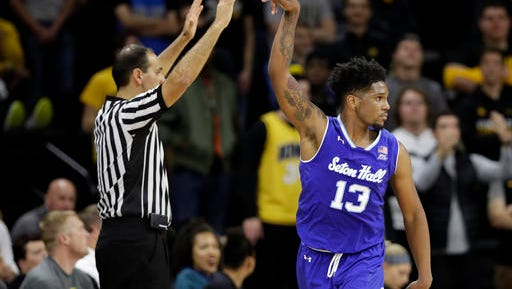Seton Hall guard Myles Powell reacts after making a 3-pointer at Iowa.