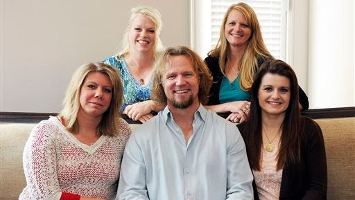 """Kody Brown poses with his wives at one of their homes in Las Vegas. Utah's attorney general has filed notice that he will appeal a ruling striking down parts of the state's anti-polygamy law in a lawsuit brought by the family on the TLC reality TV show """"Sister Wives."""" Attorney General Sean Reyes filed the notice Wednesday, about a month after a federal judge issued a final ruling in the case."""