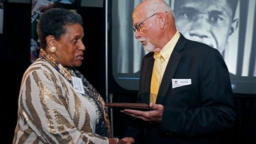 Myrlie Evers-Williams, widow of the murdered Mississippi civil rights leader Medgar Evers, receives the 2014 Mississippi Associated Press Broadcasters Pioneers of Television award from retired Jackson, Miss., bureau Associated Press news editor Ron Harrist for breaking the color barrier on his behalf during the organization's annual awards dinner in Jackson, Miss., Saturday, April 26, 2014. Evers led efforts to be granted equal air time for a social justice commentary at a Jackson television station in 1963. His appearance and subsequent on-air speech on the goals of the Jackson movement of the NAACP were the first for a black person at WLBT-TV. Evers was killed outside his home later that month. (AP Photo/Rogelio V. Solis)