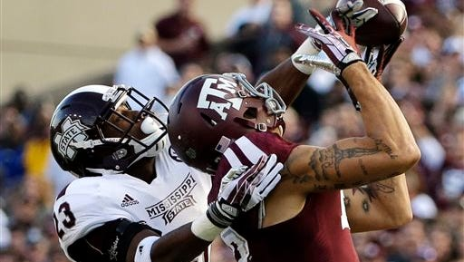 Mississippi State defensive back Taveze Calhoun (23) breaks up a pass intended for Texas A&M wide receiver Mike Evans (13) during the second quarter of an NCAA college football game Saturday, Nov. 9, 2013, in College Station, Texas. (AP Photo/David J. Phillip)