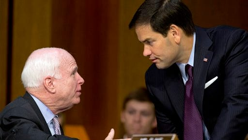 Sen. John McCain, R-Ariz., left, and Sen. Marco Rubio, R-Fla., talk on Capitol Hill in Washington, Wednesday, Sept. 17, 2014, during a Senate Foreign Relations Committee hearing on the U.S. strategy to defeat the Islamic State group. (AP Photo/Carolyn Kaster)