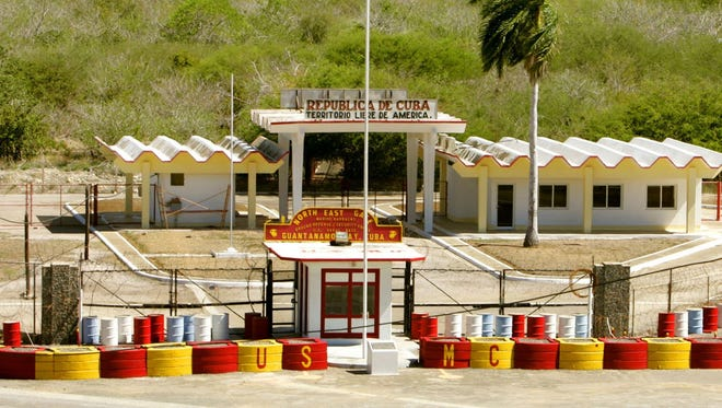 The northeast gate that leads into Cuba at Guantanamo Bay Naval Base is shown.