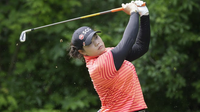 Ariya Jutanugarn watches a tee shot during the third round of the LPGA Volvik Saturday at Travis Pointe CC in Ann Arbor. Her three-iron from the rough on No. 18 set up a 15-foot putt for eagle and a 10-under-206 total.
