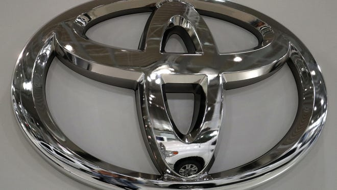 In this May 10, 2017, file photo a Toyota Land Cruiser is reflected on the emblem of Toyota Motor Corp. at Toyota showroom in Tokyo. Toyota is recalling nearly 143,000 SUVs and pickups worldwide to fix air bag and brake problems. The first recall covers about 96,000 Toyota Land Cruisers and Lexus LX570 SUVs from 2008 through 2019.