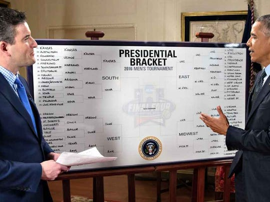President Barack Obama fills out his NCAA bracket in the Map Room at the White House.