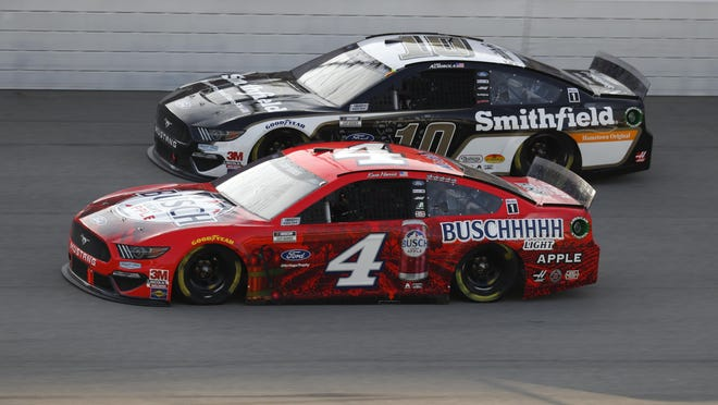 Kevin Harvick (4) races Aric Almirola (10) during a NASCAR Cup Series auto race at Michigan International Speedway in Brooklyn, Mich., Sunday, Aug. 9, 2020.