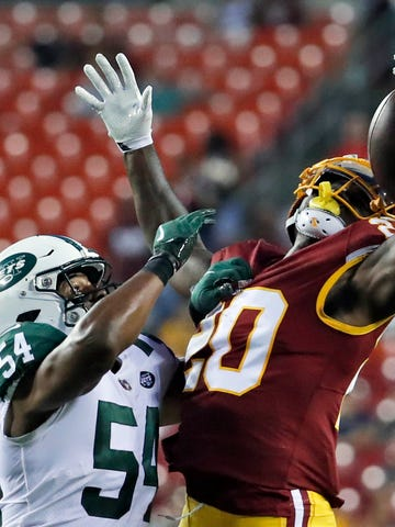 New York Jets linebacker Avery Williamson (54) breaks up a pass intended for Washington Redskins running back Rob Kelley (20) during the first half of a preseason NFL football game Thursday, Aug. 16, 2018, in Landover, Md. (AP Photo/Alex Brandon)