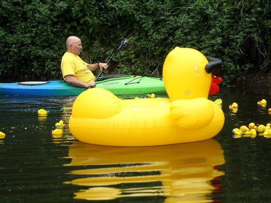 Mark Rooney of Denville keeps the ducks moving down the Rockaway River during the 9th annual Great Denville Duck Race at Gardner Field hosted by the Denville Sunrise Rotary Club. Proceeds benefit many charitable projects sponsored by the club. June 17, 2017, Denville, NJ.