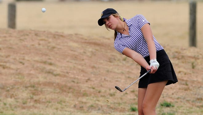 Wylie's Maddi Olson follows her shot from just off the No. 17 green during the Region 1-4A tournament second round at Shadow Hills Golf Course in Lubbock on Thursday. Olson repeated as region champion with a 6-under, 138 as the Lady Bulldogs shot a school-record 309 in the second round to finish as region runnerup.