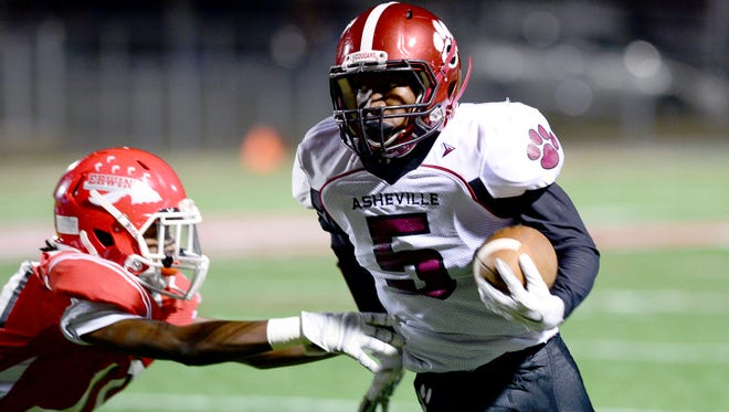 Taejon Griffin (5) carries the ball for Asheville High in Thursday's 44-25 win at Erwin.