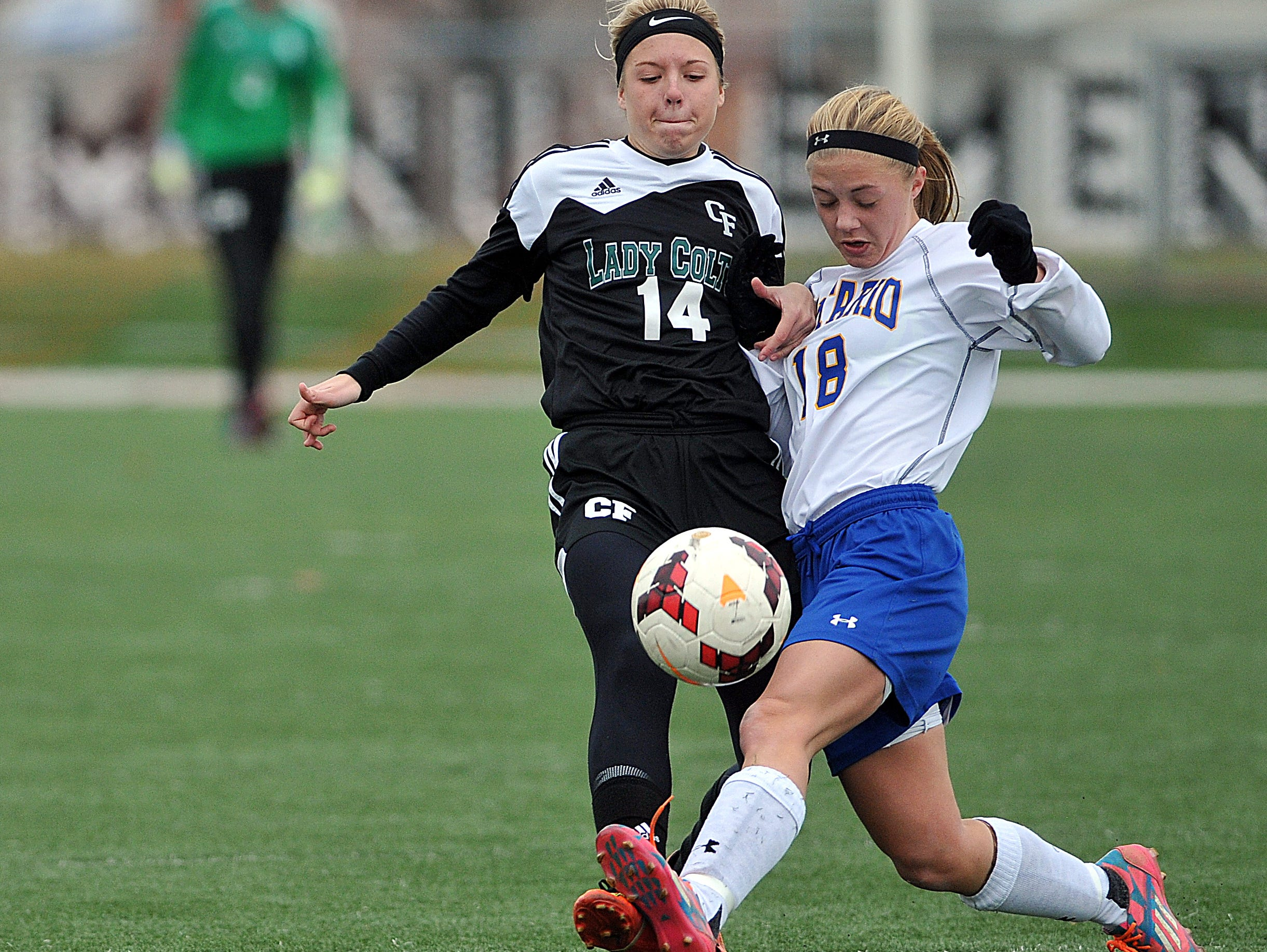 Clear Fork's Brittney Hart and Ontario's Bria Meisse battle for the ball during the girls soccer district championships Saturday at Ashland High School.