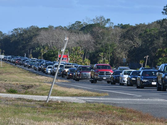 Spectators clog State Road 405 after the SpaceX Falcon Heavy launch in February.