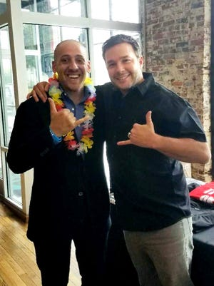 Travis Pipes (right) hangs out with Kevin Hines last summer at a mental health convention in Atlanta. Pipes credits Hines, who survived a jump from the Golden Gate Bridge in 2000, with saving his life when he was contemplating suicide.