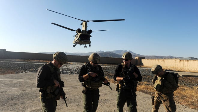 U.S. soldiers take position as a helicopter lands after 333 special force unit military maneuver in Mohammad Agha district of Logar province, Afghanistan, on Nov. 30, 2017.