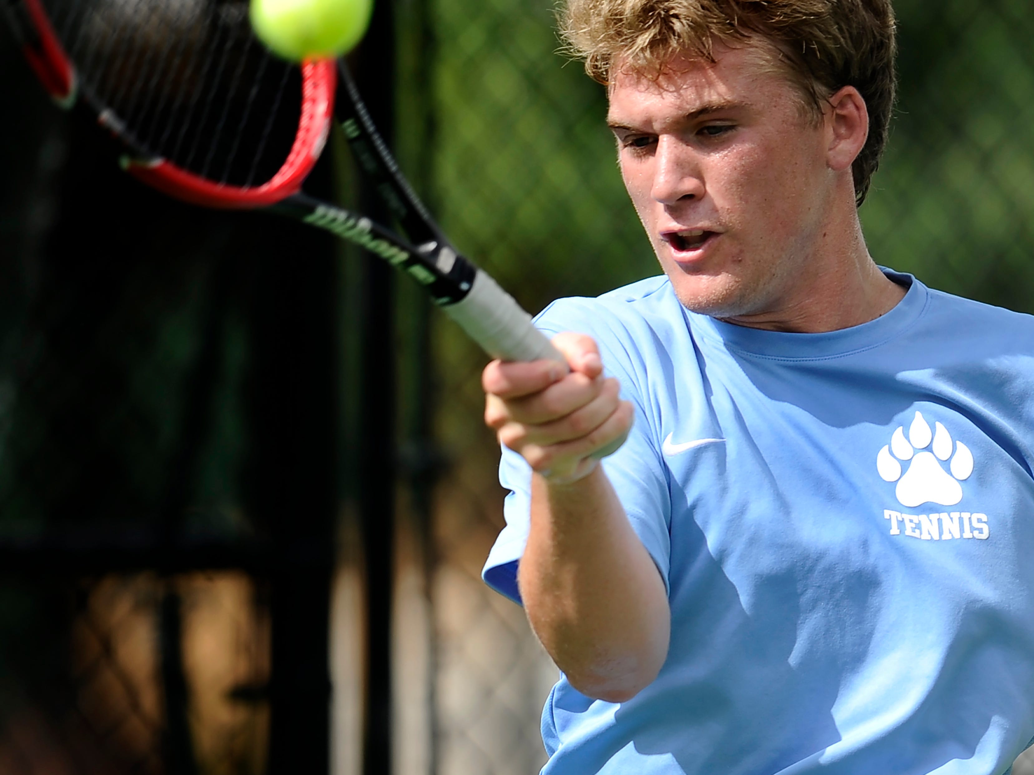 USJ's Hollen Spencer of USJ returns a serve against Lebo Hunter of USN during their tennis match at Old Fort Park Tuesday in Murfreesboro.