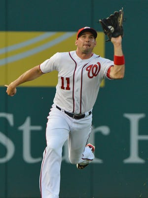 Ryan Zimmerman handles a Chase Utley fly ball during his debut in left field.
