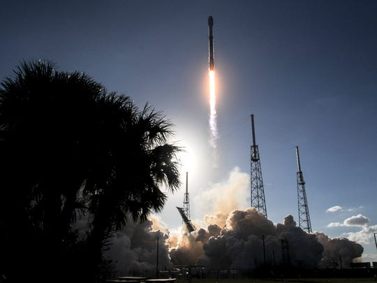 A SpaceX Falcon 9 rocket lifts off from Complex 40 at Cape Canaveral Air Force Station Wednsday afternoon, Jan. 31, 2018.  The rocket is carrying a communications satellite for SES and the government of Luxembourg.