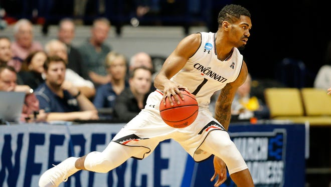 Cincinnati Bearcats guard Jacob Evans (1) crosses over in the first half of the NCAA Tournament Second Round game between the Cincinnati Bearcats and the Nevada Wolf Pack at Bridgestone Arena in Nashville on Sunday, March 18, 2018. The Bearcats led 44-32 at halftime.