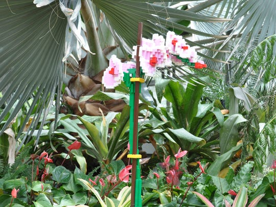 Sean Kenney said the pink Lego bricks used in this moth orchid sculpture are limited and difficult to find.