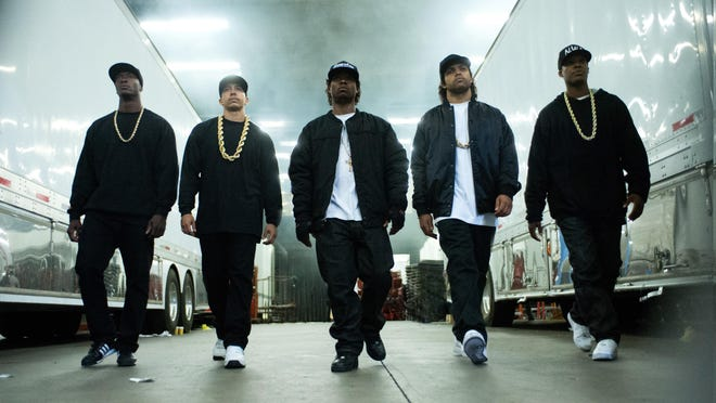 """This photo provided by Universal Pictures shows, Aldis Hodge, from left, as MC Ren, Neil Brown, Jr. as DJ Yella, Jason Mitchell as Eazy-E, O'Shea Jackson, Jr. as Ice Cube and Corey Hawkins as Dr. Dre, in the film, """"Straight Outta Compton."""" The movie releases in U.S. theaters on Friday."""