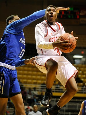 Lee's Roderic Scott (3) goes to the basket against Auburn's Garrison Brooks (10) in AHSAA Central Regional action at the ASU Acadome at Alabama State University in Montgomery, Ala. on Wednesday February 11, 2015.