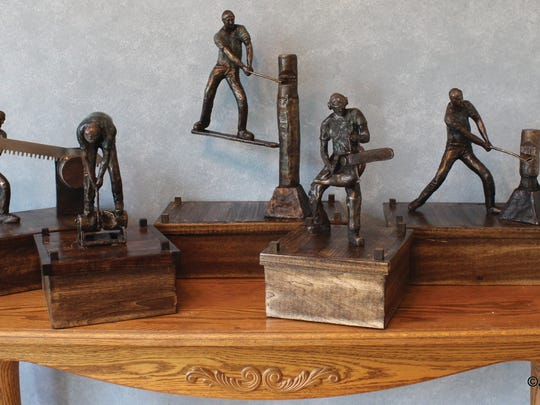 """""""Celebrating the Art in Timber Sports"""" features work by bronze sculptor John Hallett of Oconomowoc and photographers Steve Davis of LaCrosse and Richard Magnone of Wauconda, Illinois."""