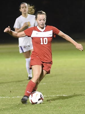 Jackie Davis moves the ball down the field.