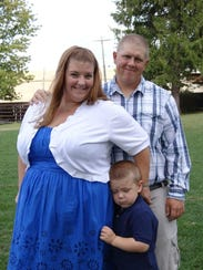 Megan Dix with her husband Chris and son CJ.