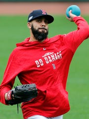 Boston Red Sox pitcher David Price throws a heavy ball during a baseball workout at Fenway Park, Thursday, Oct. 4, 2018, in Boston, in preparation for Game 1 of the ALDS against the New York Yankees on Friday. (AP Photo/Elise Amendola)